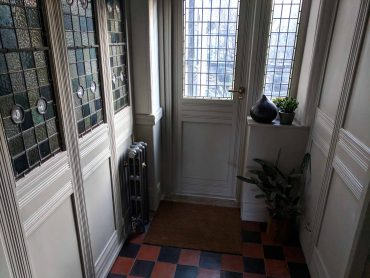 quarry tile hall with stained glass door